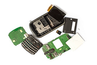 Disassembled mobile phone parts on white background